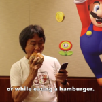 Nintendo Super Mario Run Shigeru Miyamoto iPhone 7 One handed play while eating hamburger